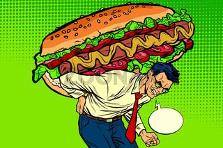 man carries a huge hot dog sausage with salad