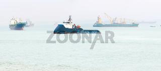 Industrial cargo ships Singapore harbor