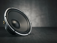 Loudspeaker.  Multimedia acoustic sound speaker on black background.