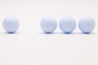 White golf balls on the white background.