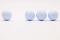 White golf balls on the white background.