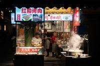 Food stall operating at night
