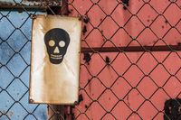 Danger of Death Sign on Wire Mesh Fence