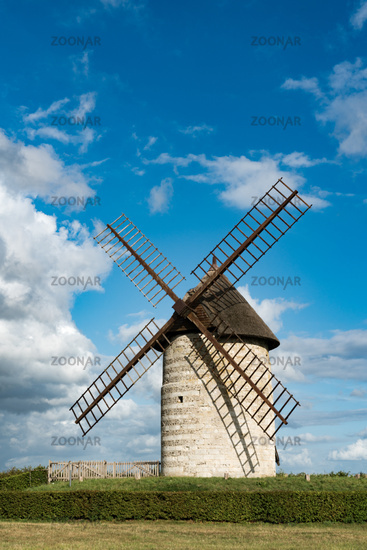 vertical view of the historic windmill Moulin de Pierre in Hauville in Normandy
