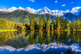 The Alps are reflected in the lake
