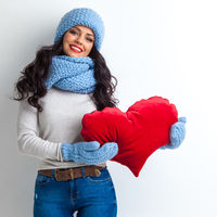 Woman in hat holding heart