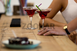 Beauty couple having fun at cafe with cocktails