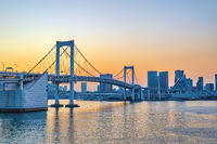 Tokyo Japan, sunset city skyline at Odaiba Rainbow Bridge