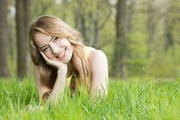 Girl laying on the grass