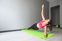 Young woman doing exercises on the floor