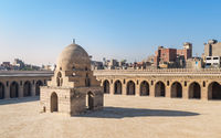 Courtyard of Ibn Tulun public historical mosque with ablution fountain and arched passages, Medieval Cairo, Egypt