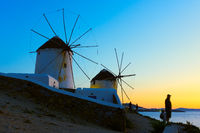 Windmills on the seashore in Mykonos at sundown
