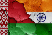flags of Belarus and India painted on cracked wall
