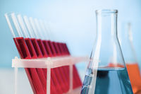 Abstract design of chemistry research glassware on lab table