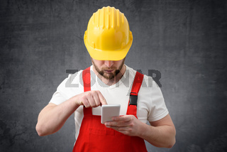 Construction worker using smartphone