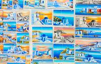 Paintings at window of souvenir shop