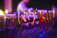 Bar counter with bottles in blurred background in the night