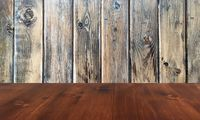 old brown oak wooden table on the blurry wood wall background, wood table