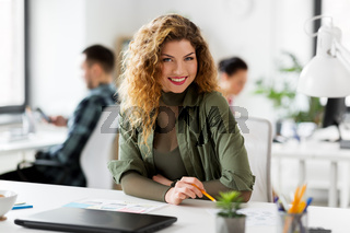 creative woman working on user interface at office