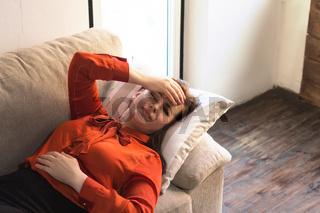 Beautiful lady having rest on sofa.