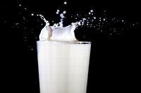 Glass with splashing milk