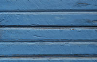 Weathered wooden background painted blue
