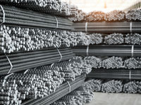 Reinforcement bars stacks. Metal products in metallurgical plant or warehouse. Industriall concept.
