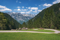Alpine road in the Swiss Alps on a sunny day