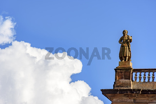Statue on top of historic building in baroque style