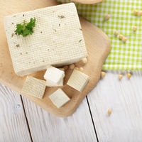 Flat lay view at Soy Bean curd tofu on cutting board Non-dairy alternative substitute for cheese