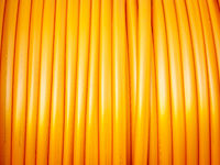 communication cable in orange on a roll