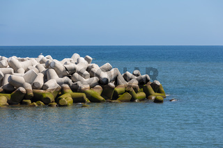 Breakwater of tetrapods at the Atlantic coast of Madeira, Portugal