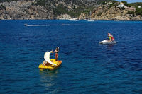 Girl rented toy boat near coast