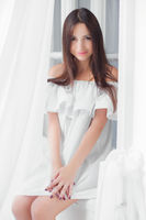 Portrait attractive woman dressed in white dress.