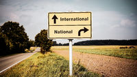 Street Sign to International versus National