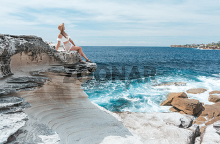 Female enjoying the summer sun by the coast in Australia