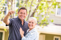 Caucasian Couple in Front of House with Keys