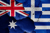 flags of Australia and Greece painted on cracked wall