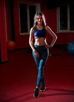 Young sporty woman in fitness club