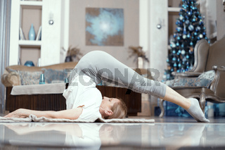 Charming woman lays on her back stretching
