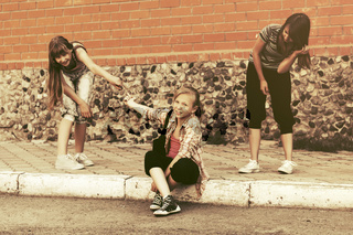 Group of happy teen girls having fun in city street