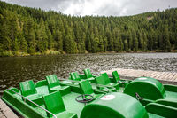 Tourist or fishing boats on a mountain lake