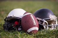 American football helmets and ball