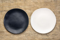 black and white plates on textured paper