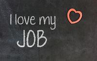 Blackboard with small red heart - I love my job