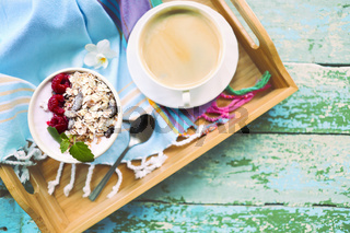 Cup of granola with yogurt and fruit
