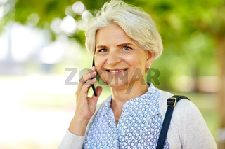 senior woman calling on smartphone in summer