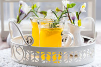 Fresh lemon drink with rosemary in glass cup