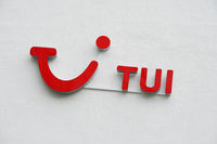 TUI logo and brand sign