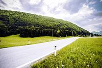 Asphalt road in Austrian landscape